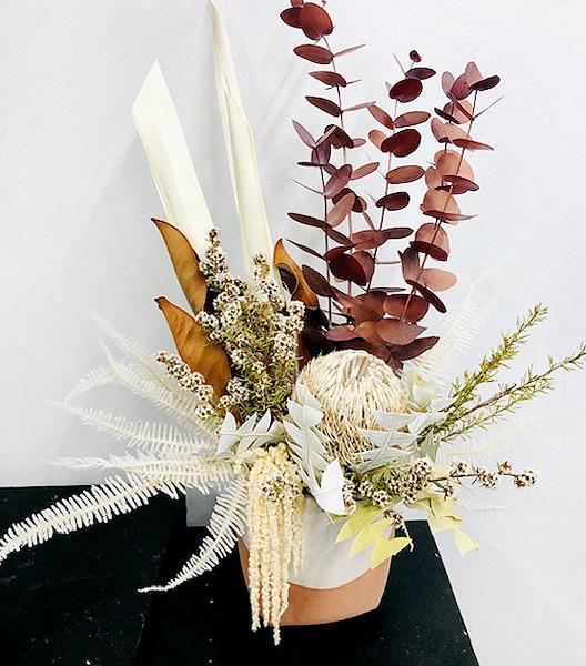 Warm toned wild flowers in vase