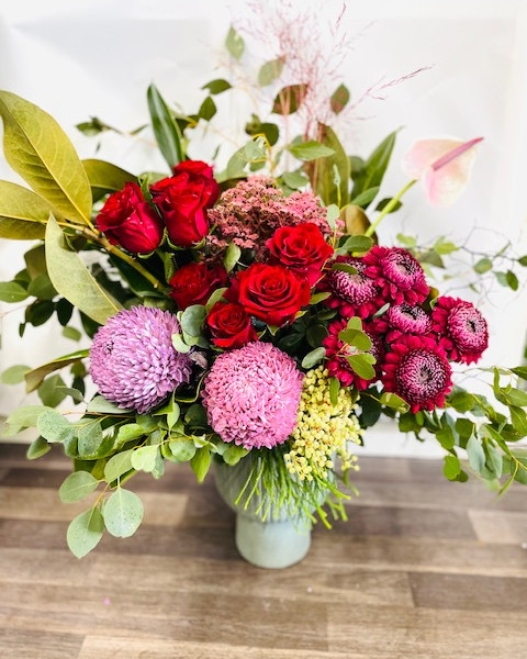 premium red roses bouquet delivered